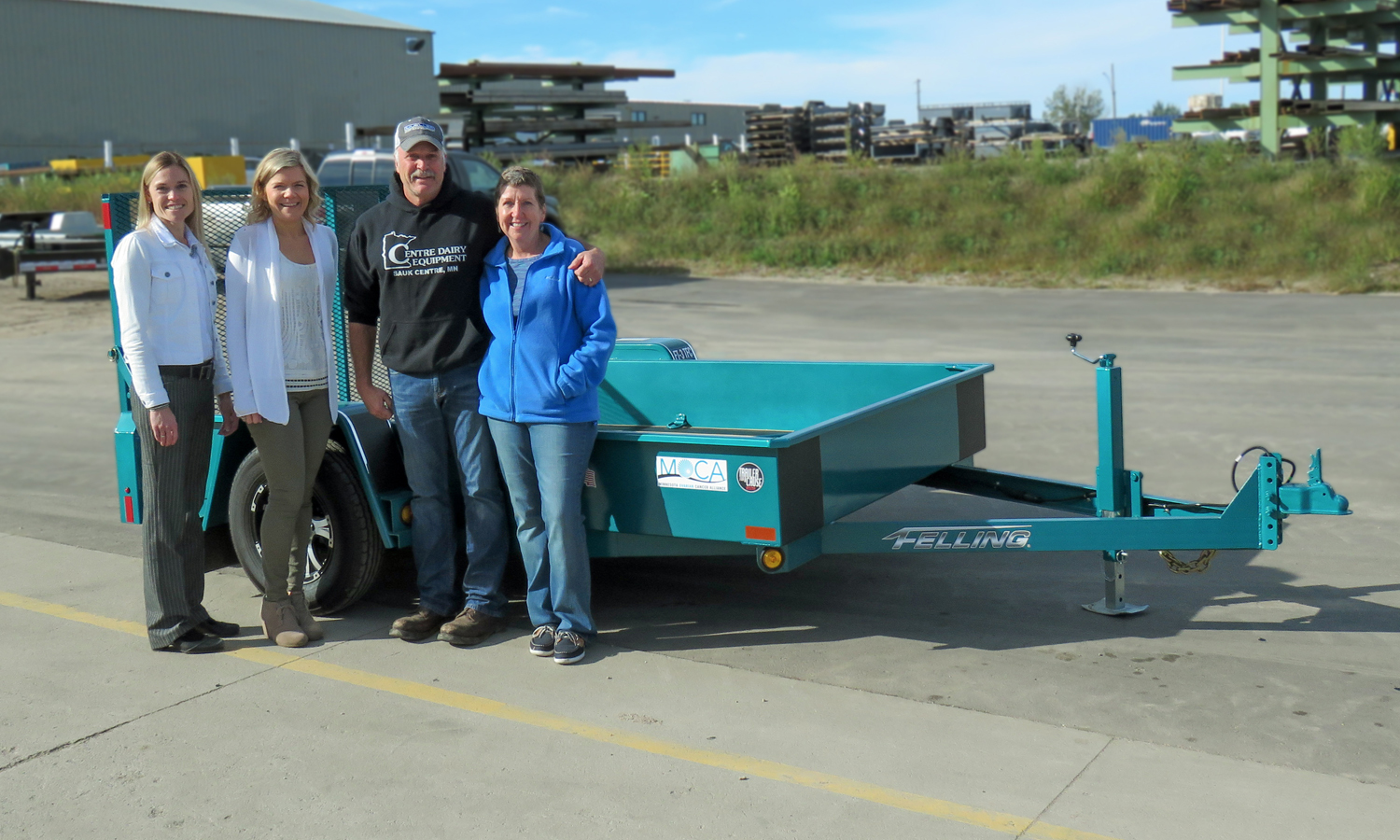 Felling Trailers co-owners, CEO Brenda Jennissen and Vice President of HR Bonnie Radjenovich, and bid winners Jon and Laurie Stein, Centre Dairy Equipment & Supply Inc.